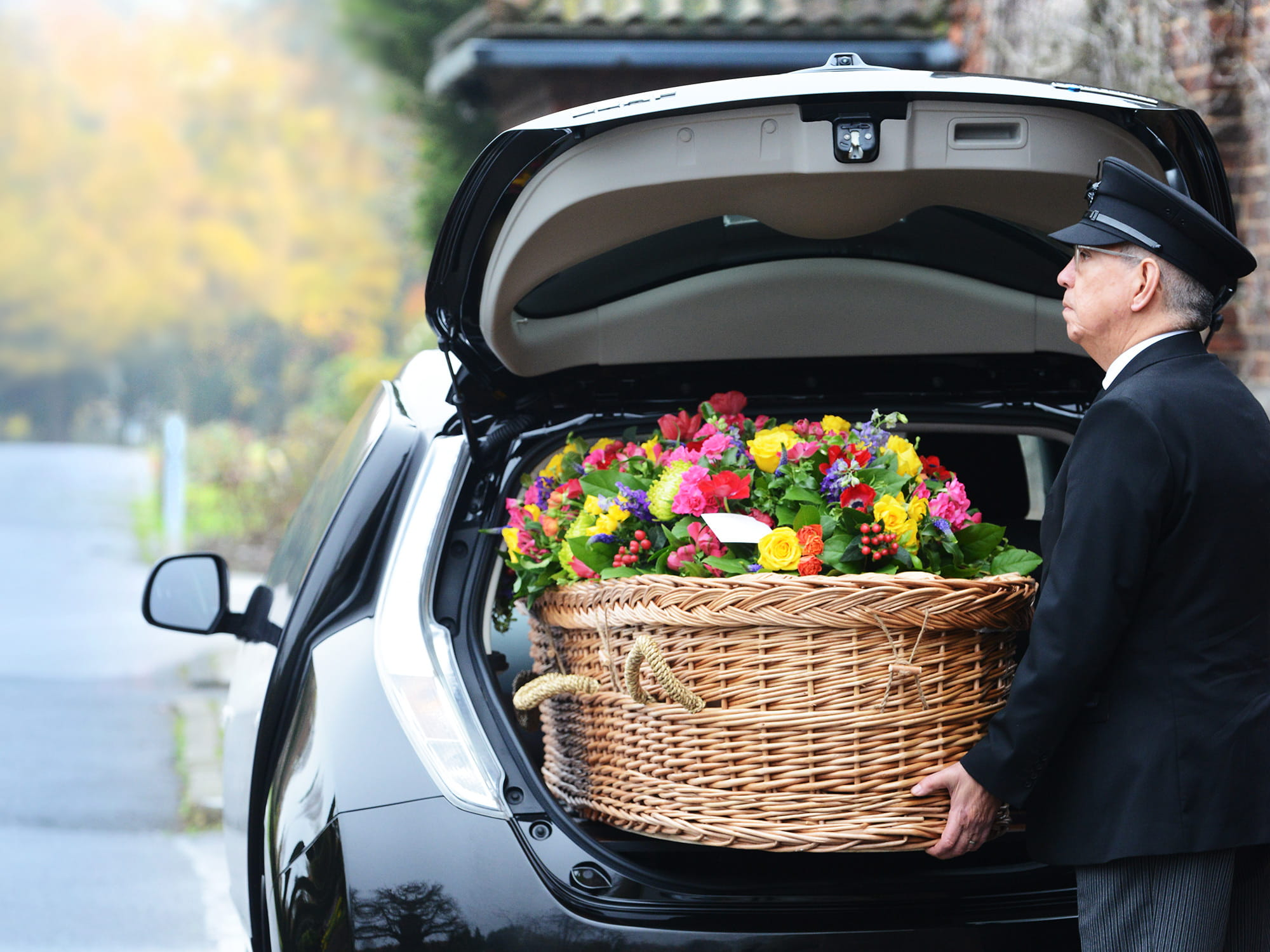 Electric Hearse at a service with casket being loaded